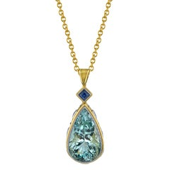 Pear Shape Aquamarine and Blue Sapphires 18 Karat Yellow Gold Pendant