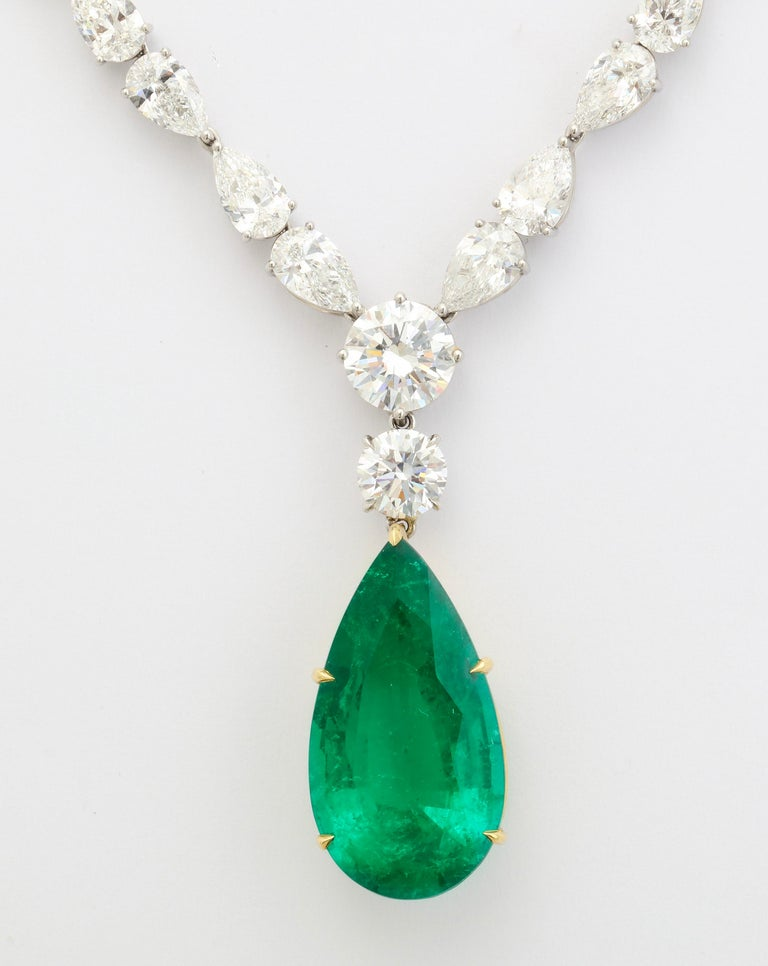 The platinum and diamond necklace features 59 diamonds (58 pear shape and 1 round) weighing a total of 32.23cts. The pendant is comprised of a pear shape Colombian emerald weighing 15.69cts with a Gübelin certificate and a 1.01cts round diamond (GIA