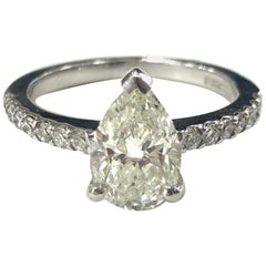 Pear Shape Diamond Single Stone Engagement Ring with Diamond Shoulders