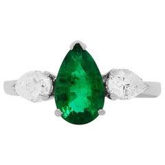 Pear Shape Emerald 18 Karat White Gold Diamond Three-Stone Ring