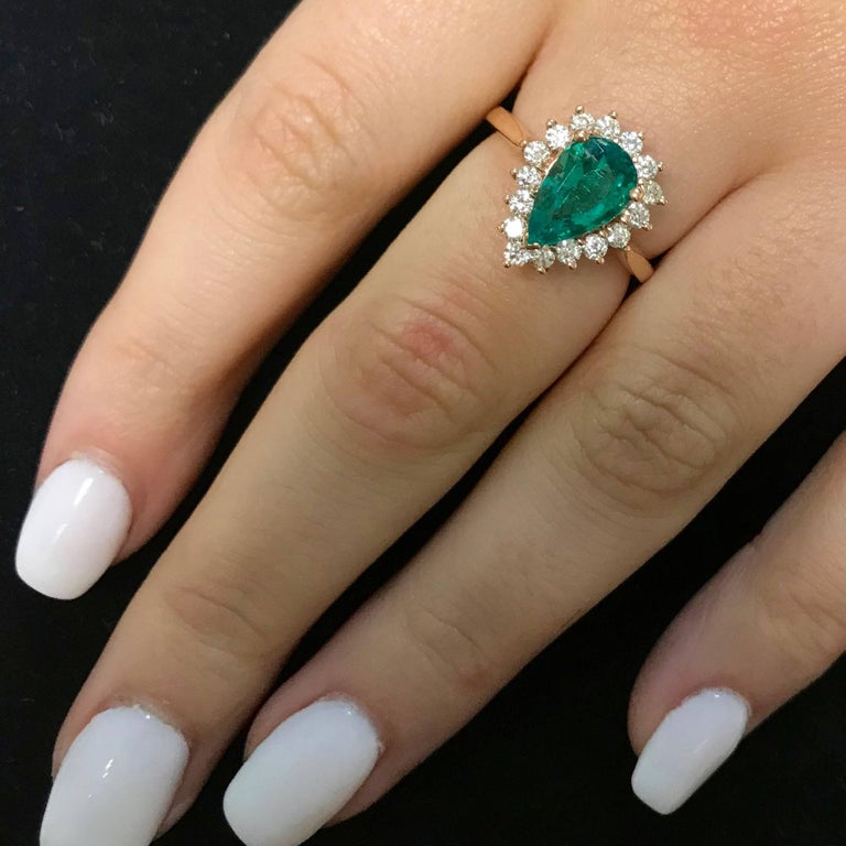 Contemporary Pear Shape Emerald Halo Engagement Ring in Rose Gold For Sale
