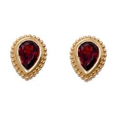 Pear Shape Garnet Stud Earrings Set in 14 Karat Yellow Gold