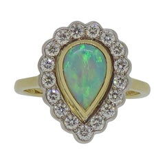 Pear Shape Opal and Diamond Cluster Ring 18 Karat Yellow and White Gold