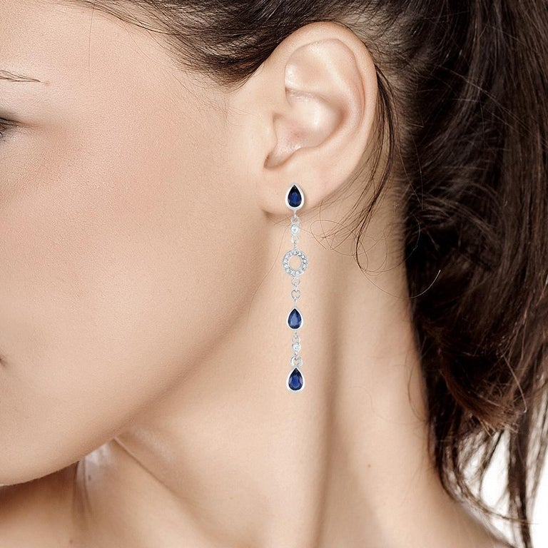 Pear Cut Pear Shape Sapphire and Diamond 2.5 Inch Long Earrings Weighing 5.60 Carat  For Sale