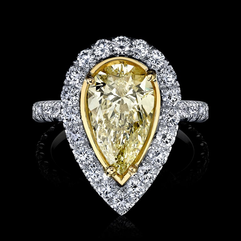 Yellow Pear Shape Diamond Ring 3.02 carats Center Diamond   Set with 2.07 carats Micro pave.  Spectacular. Set in Platinum/18KYG  Stunning! Looks like nice FANCY YELLOW.  Pear Shape Diamond weighs 3.02 carats.   Y-Z Color SI1 Clarity  With GIA