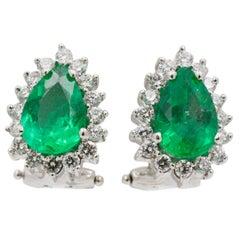 Pear Shaped Emerald Diamond Halo 18 Karat White Gold Earrings