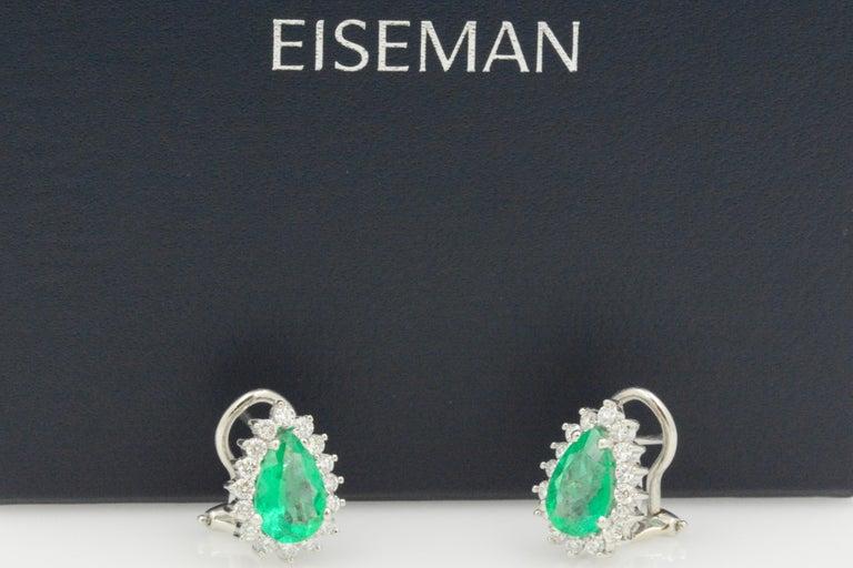 Modern Pear Shaped Emerald Diamond Halo 18 Karat White Gold Earrings For Sale