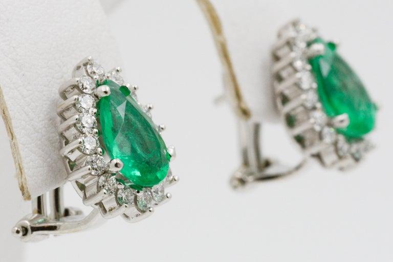 Women's Pear Shaped Emerald Diamond Halo 18 Karat White Gold Earrings For Sale