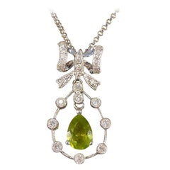 Pear Shaped Peridot and Diamond Halo Drop Necklace in 18 Carat White Gold