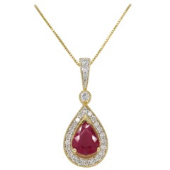 Pear Shaped Ruby and Diamond Halo Pendant in Yellow Gold