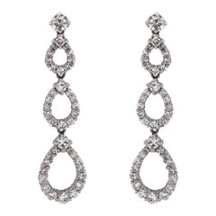 Pear Shapes Round Cut White Diamonds 4.53 Carat Dangling Platinum Earrings