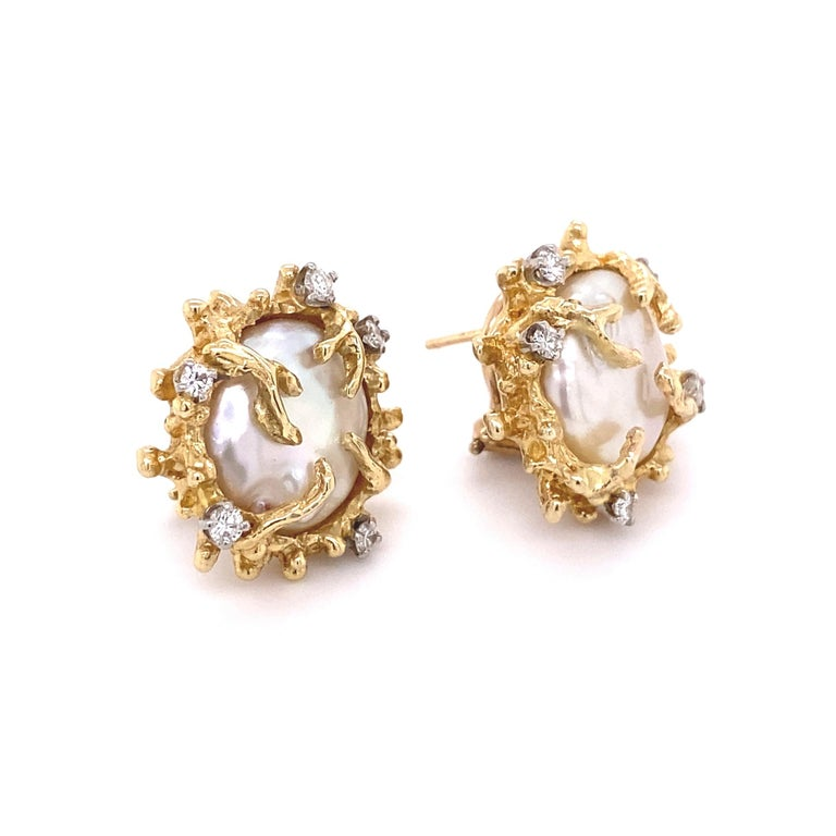 Beautiful and Stylish Yellow Gold Button Freshwater Pearl Clip-on Earrings. Accented by 10 Hand set round Diamonds weighing approx. 0.50 Carat total weight. Each earring measuring approx. 0.74