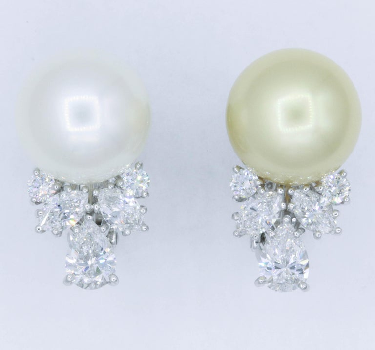 Elegant pair of mismatch pearl earrings featuring four marquise weighing 1.02 carats and four round diamonds weighing 0.37 carats, in platinum. Pearls: 13.2-13.3 MM Color: G Clarity: VS