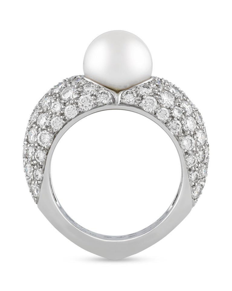 This classic and stylish ring from the celebrated house of Cartier is an elegant example of modern jewelry design. Crafted of 18K white gold, the ring is set with a 9mm white pearl at its center, while approximately 1.00 total carat of diamonds are