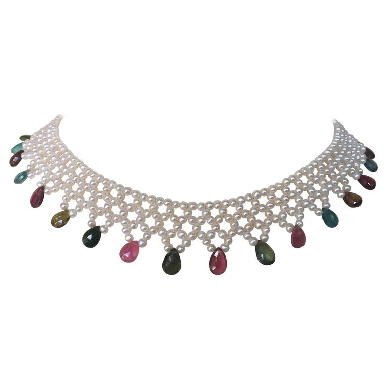 The white pearls and multi color tourmaline briolettes are woven into an elegant necklace with a vintage 14k yellow gold clasp. The small round white pearls are woven into a lace like design, finished with beautiful warm toned multi-color tourmaline