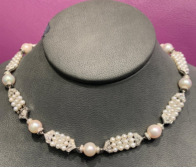 Pearl & Diamond Necklace, 18K White Gold  9 Large Size Cultured Pearls  111 Small Cultured Pearls Diamond Weight: 2.26 Cts Measurements: 16