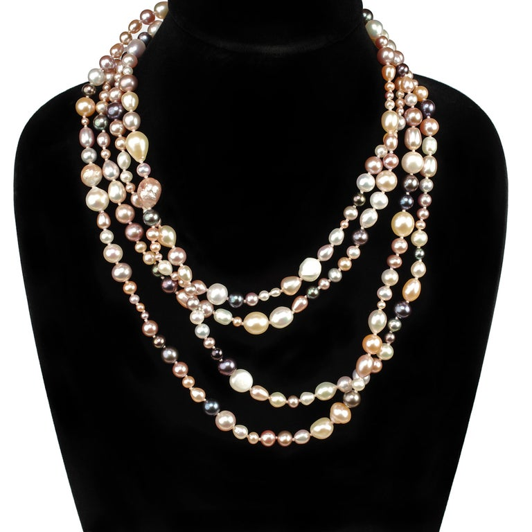 This is a dramatically spectacular and insanely, luxuriously long (over 7 foot) strand of naturally-colored cultured freshwater pearls from China. The 270 brilliantly luminous, gorgeous pearls present a spectrum of the amazing colors Chinese