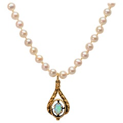 Pearl Necklace with 14 Karat Antique Style Opal Charm Pendant