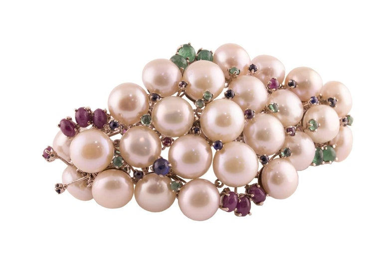 Light pink pearls bracelet in 9kt gold and silver structure mounted with natural rose cut diamonds, rubies, sapphires and emeralds. Pearls (55.70 g)  Diamonds (0.36 kt) Rubies, Sapphires and Emeralds (17.96 kt) Tot.weight 90.80 g R.F iaii  For any