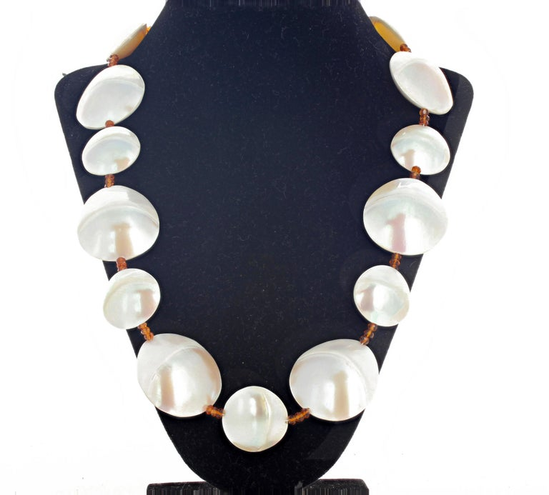 These fascinating highly polished double sided Pearl Shells are enhance with sparkling gemcut natural Hessonite Garnets in this lovely 23 inch long necklace with gold plated easy to use hook clasp.  This can be shortened for free if too long for