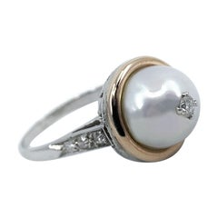 Pearl Solitaire Ring in Platinum and Rose Gold with Diamond Accents, Circa 1950