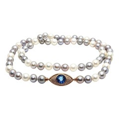 Pearls Necklace with 18 Karat Gold, Diamonds and London Blue Topaz Eye Clasp