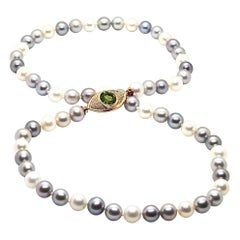 Pearls Necklace with 18 Karat Gold, Diamonds and Peridot Eye Clasp