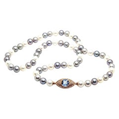 Pearls Necklace with 18 Karat Gold, Diamonds and Sky Blue Topaz Eye Clasp