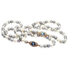 Pearls Necklace with 18 Karat Gold, Diamonds and Swiss Blue Topaz Eye Clasp