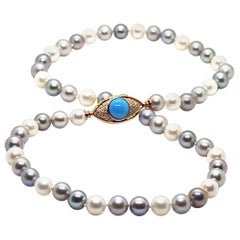 Pearls Necklace with 18 Karat Gold, Diamonds and Turquoise Eye Clasp