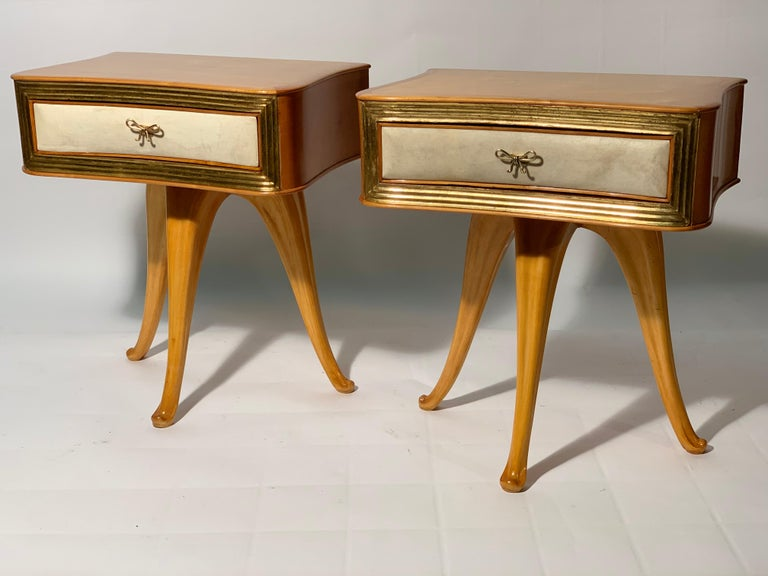 Night stands or side table in solid sculptured maples 3 legs structures, convex and concave drawer in the central part covered in natural parchment and framed with grooved decorative details in real gold leaf.