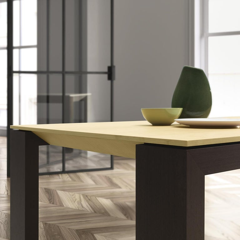 This all-wood table will be a beautiful centerpiece for any dining or living space with a contemporary flare. Sleek design and simple forms are what this long, rectangular table is all about, with dark kotò wood frame and legs and a smooth, light