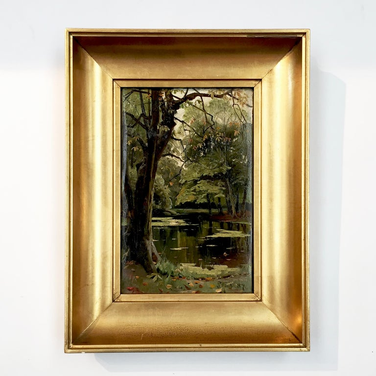 Peder Mønsted (b. 1859, d. 1941). Forest scenery, late summer. Oil on canvas. Sign. P. Mønsted 1889. An atmospheric and charming little picture. Underframe with stamp from: L.Noch, Pilestræde 41, Copehagen With/without frame (cm): H 27/20 – W