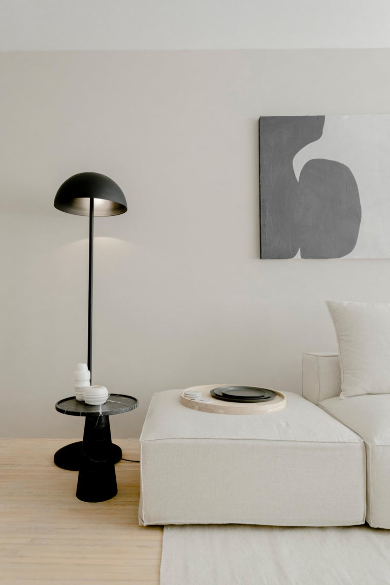 Side table in carved black Monterrey marble.