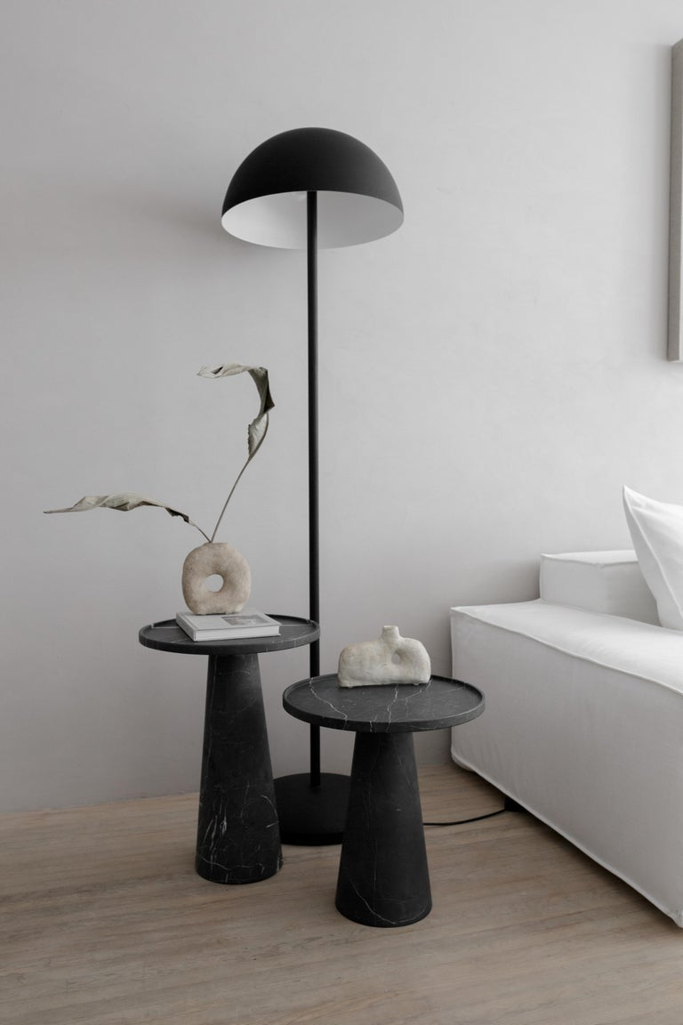 Side table in carved Monterrey black marble. Handmade in Mexico by local craftsmen.