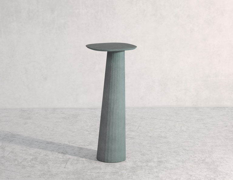 Pedestal part of a collection of modular system in ultra high performing cement mortar. UHPC colored in the mixture and sandblasted. Available in eight different colors: Brick, silver, powder, cream, fir, dark, chocolate, ink and ultra marine. Each