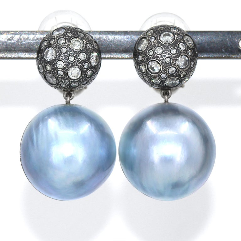 One of a Kind Earrings hand-fabricated by acclaimed master metalsmith and maker Pedro Boregaard showcasing 2.75 total carats of round brilliant-cut diamonds bezel-set in a domed, intricately-textured oxidized sterling silver dome top above a