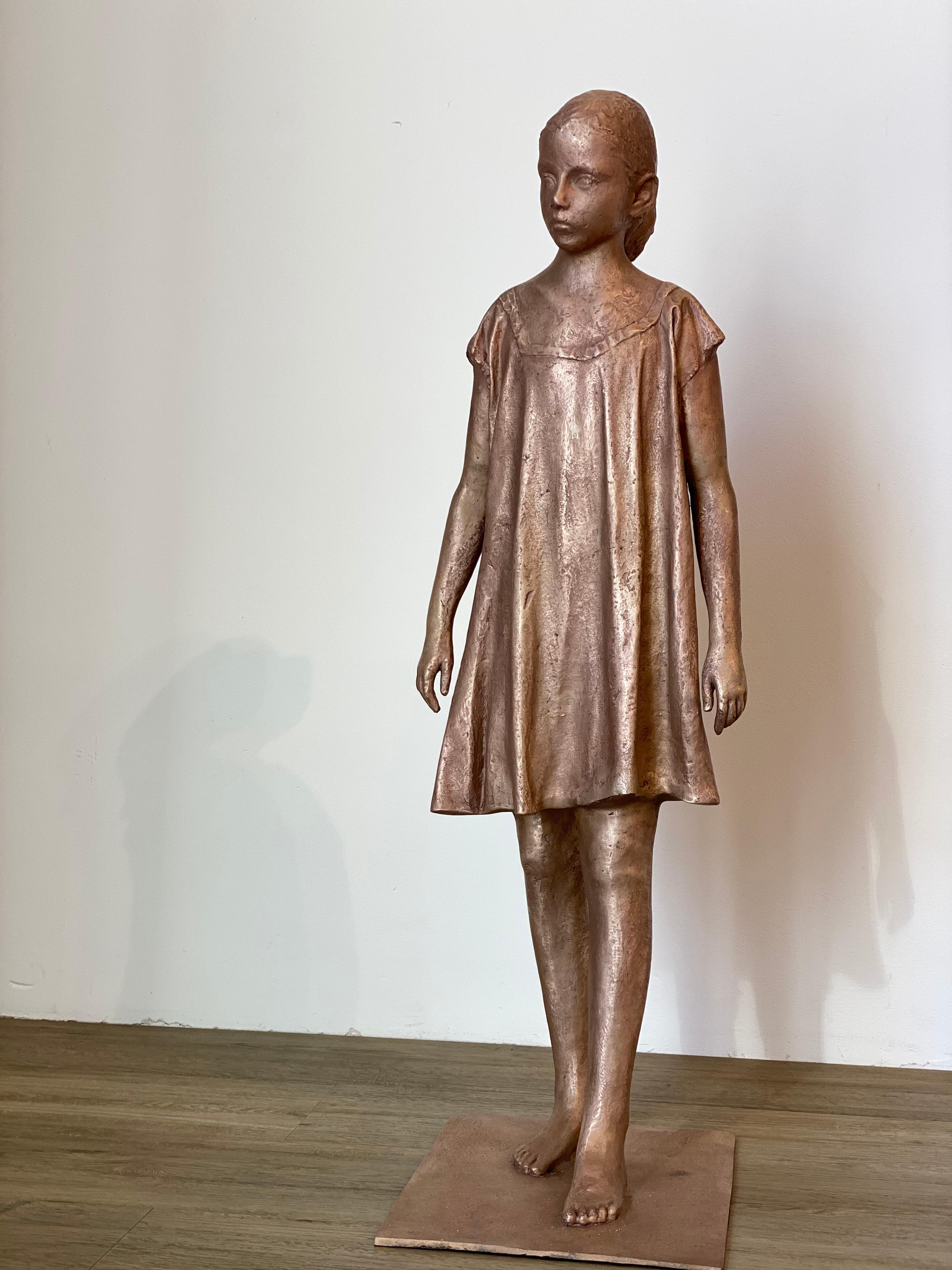 Girl, Walking- 21st Century Bronze Sculpture of a Young Girl in a Dress Walking.