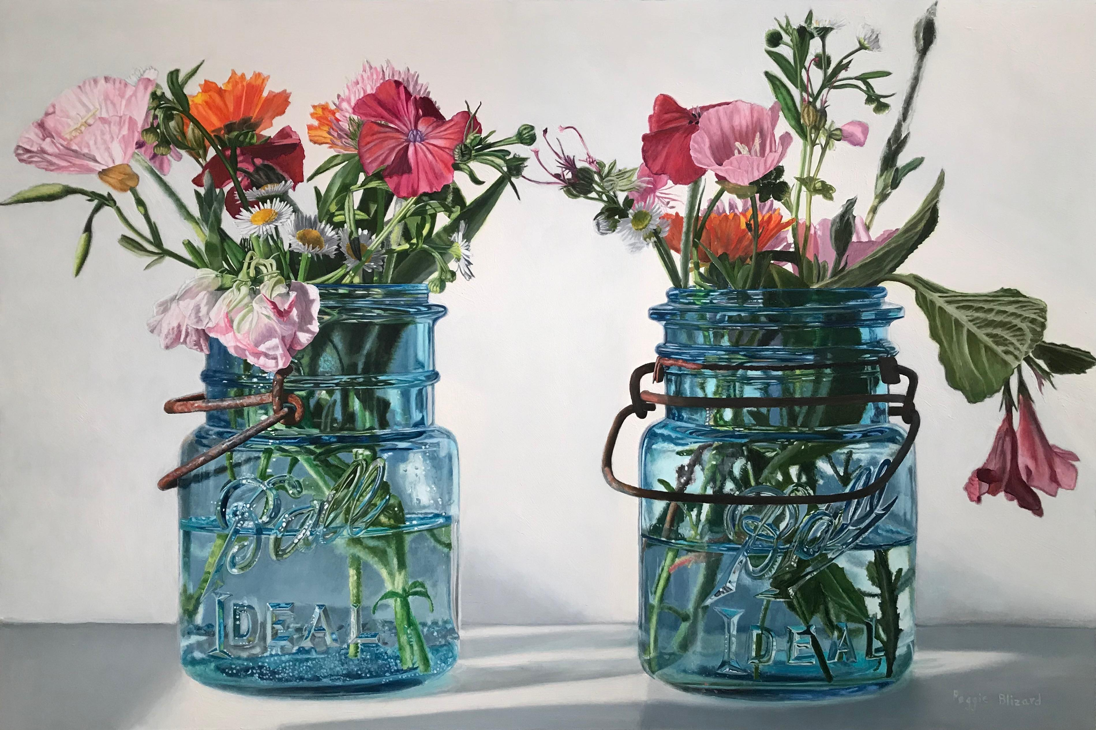 Pink Flowers in Small Blue Jars