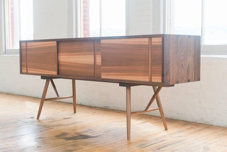 Contemporary Pelican Cabinet, Modern Walnut Sideboard with Sliding Doors and Turned Legs For Sale