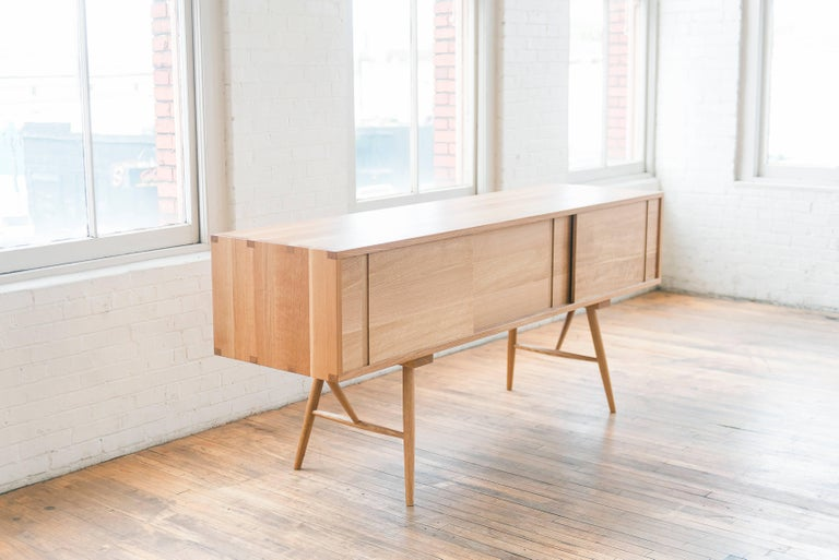 American Pelican Cabinet, Modern White Oak Sideboard with Sliding Doors and Turned Legs For Sale