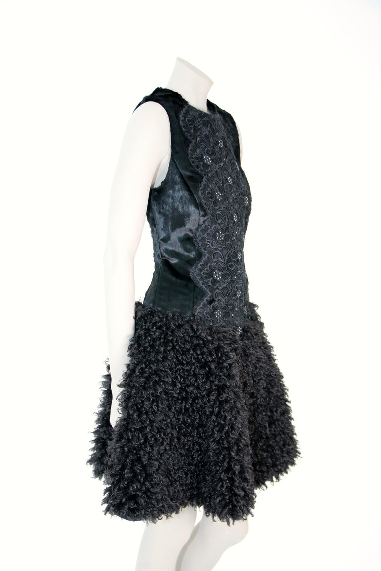 The Mia Pelush black faux fur dress with guipure lace and Swarovski crystals is a one of a kind exclusive piece. Featuring the highest quality man made pelage, this original fur free dress is a fun replica of a boucle' curly lamb fur, combined with