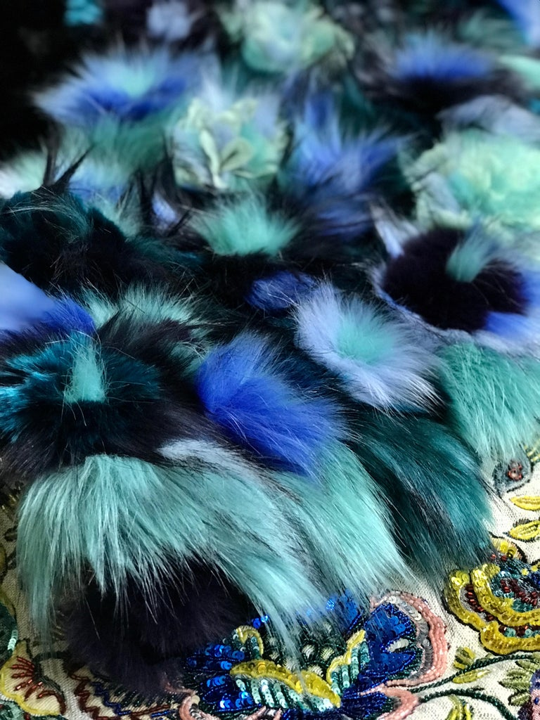 The Jackie Pelush faux fur Astrakhan dress with three dimensional flowers is a one of a kind exclusive Couture piece. Featuring the highest quality man made pelage, this extraordinary fur free dress is a beautiful replica of the Astrakhan,