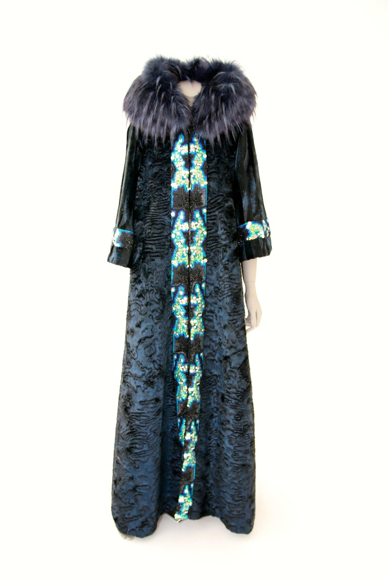 The Regina Pelush blue faux fur Astrakhan caftan coat with embroidery is a one of a kind exclusive Couture piece. This striking eye-catching fur free coat is crafted with the highest quality man made pelage for Pelush. The rich and sumptuous fabric