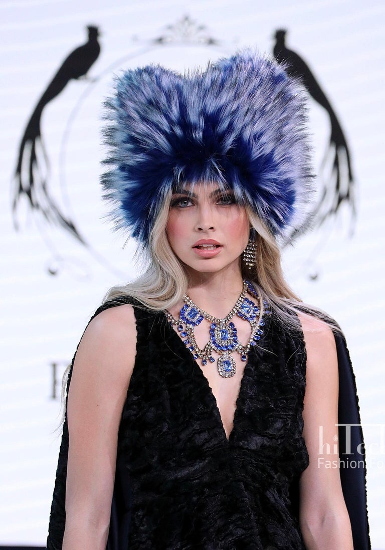 The Anastasia Pelush cobalt blue faux fur fox hat is a one of a kind exclusive piece. Featuring the highest quality man made pelage, this over the top fur free hat makes a striking fashion statement. The beautiful and soft fabric is a stunning