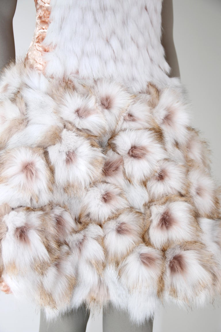 The Bianca Pelush white faux fur dress with three dimensional flowers is a one of a kind exclusive Couture piece. Featuring the highest quality man made pelage this extraordinary fur free dress is a beautiful replica of the chinchilla, fox and