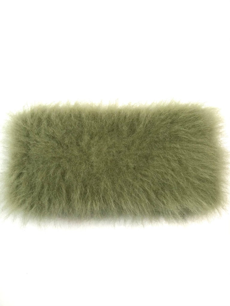 This beautiful pair of Pelush faux fur scarfs are sold as a set and they are one of a kind. Featuring the highest quality man made pelage, these soft and elegant neck warmer in green shades are a perfect replica of the chinchilla and alpaca fur.