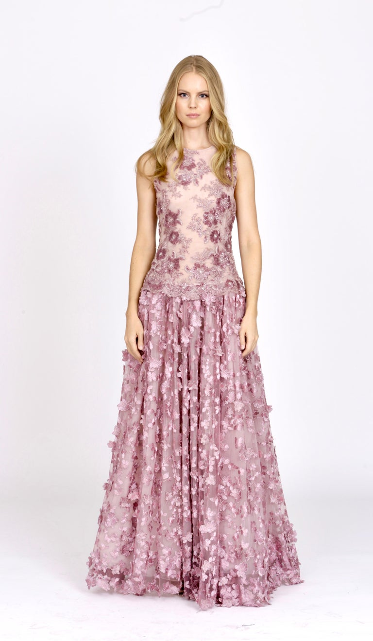 The Grace Pelush pink tulle dress gown with three dimensional flowers and embroidery is a one of a kind exclusive Couture piece. Adorned with cascading butterfly floral petals, lace sparkling sequins, pearls, metallic lurex threads and constructed
