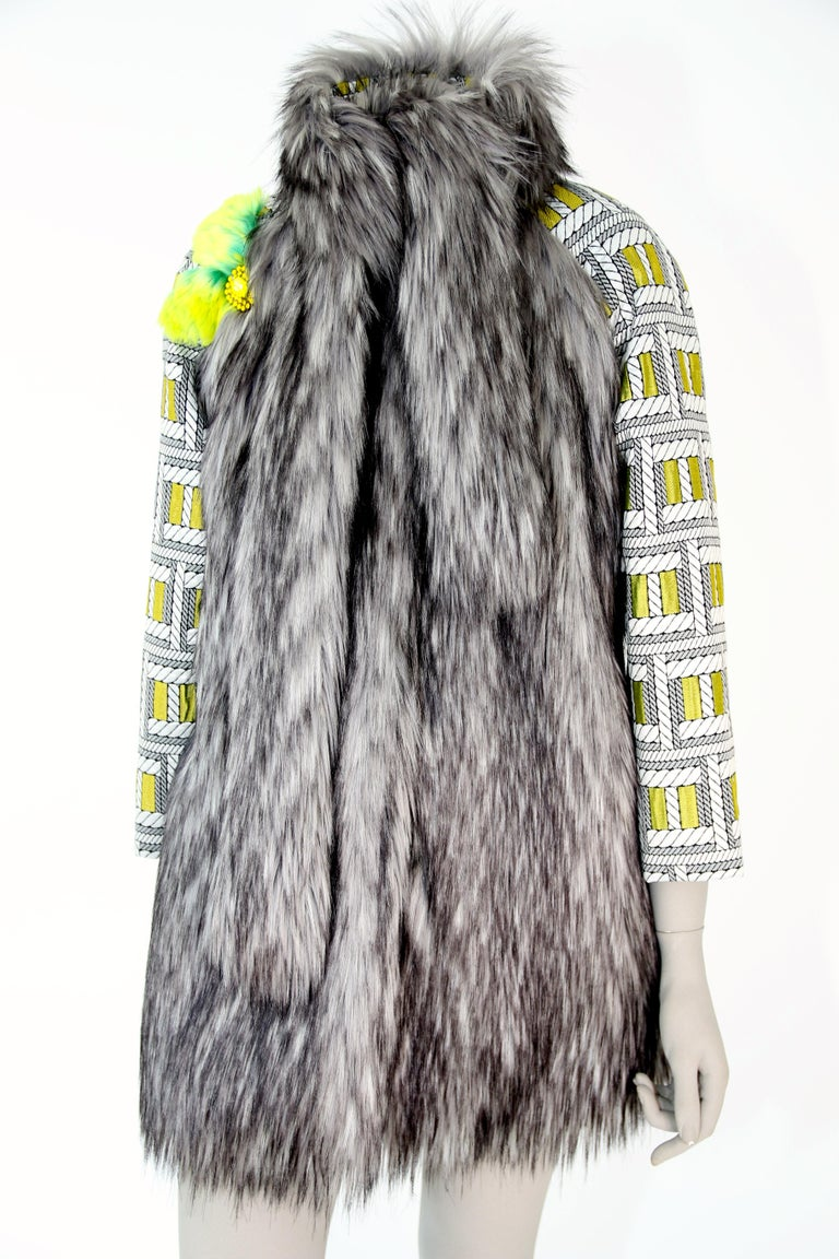 The Lulu Pelush silver gray faux fur fox jacket with brocade sleeves is a one of a kind exclusive piece. Featuring the highest quality man made pelage this unique fur free jacket is a beautiful replica of the long hair silver fox fur. Soft and