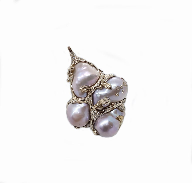 A stunning pendant by Bibi van der Velden made of white gold, spectacular baroque pearls and white diamonds 0.81 carats. For glamourous evenings or chic daytime appearances, with this pendant you will always be adored. Matching ring available.  Bibi